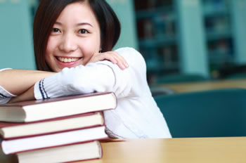 Student with books.
